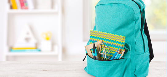 backpack loaded with school supplies