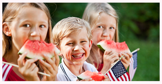 Kids enjoying watermelon